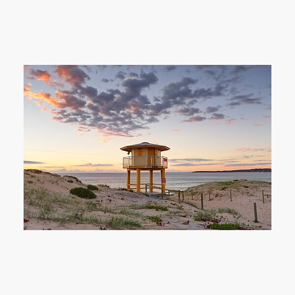 Lifeguard tower at the beach with pretty sunrise Photographic Print