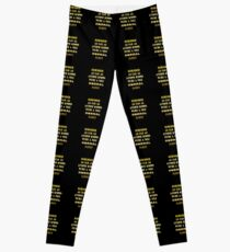 "Gold lettering with the message ""We're A Nice Normal Family"". Leggings"