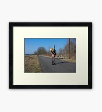 Blue sky, black nylons Framed Print