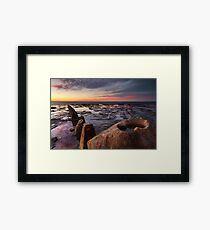 Sunrise and reflections on coastal rockshelf Framed Print