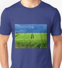 Green grass field with dramatic beautiful sky background T-Shirt