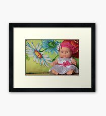 moppet doll sitting on a flower Framed Print