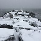 Snow covered rocks by Jacker