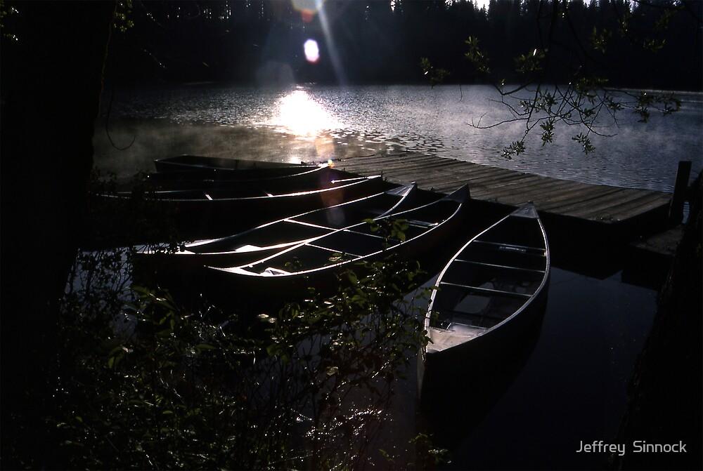 Early morning canoes by Jeffrey  Sinnock