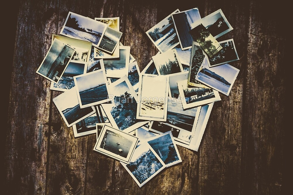 Heart-shaped instant photographs on wooden background by Ryan Jorgensen