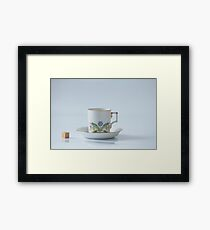 Beautiful cup with flower and piece of sugar Framed Print