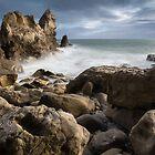 Rocky beach of Corona Del Mar, CA by Bradley Hebdon