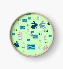 pattern with nesting box, rabbits and fence. Clock