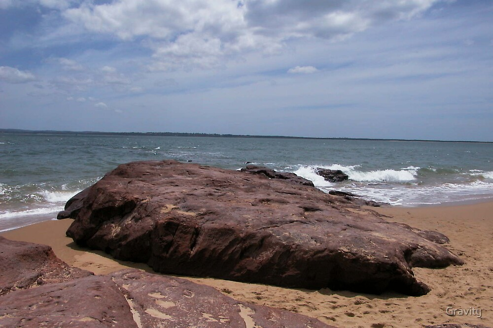 A rock and a sandy place by Gravity