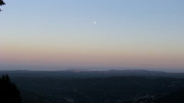 Cote d'Azur moon at dusk by Brian Robertson