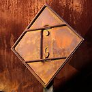 Triangle in Rust, Train Hazard Placard  by Larry Costales