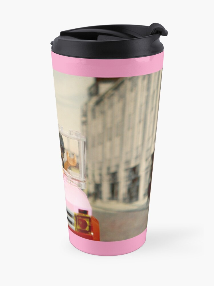 Alternate view of Legoman arrives to town streetscape Travel Mug