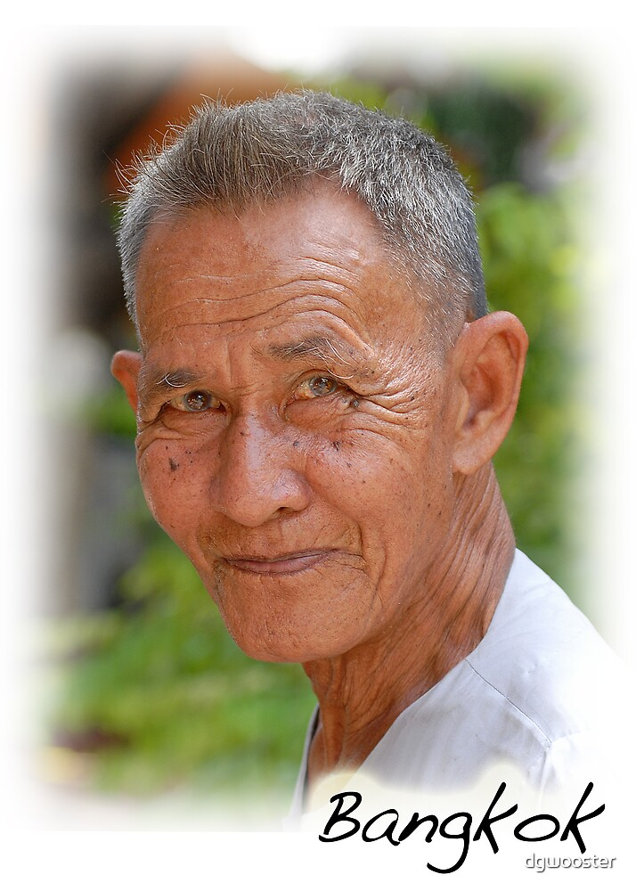 Thai man in Bangkok temple by dgwooster