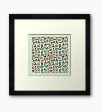 A pattern of robots and aliens. Framed Print