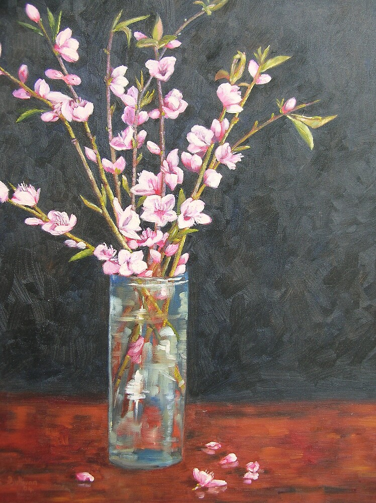 Blossoms in vase by avocado