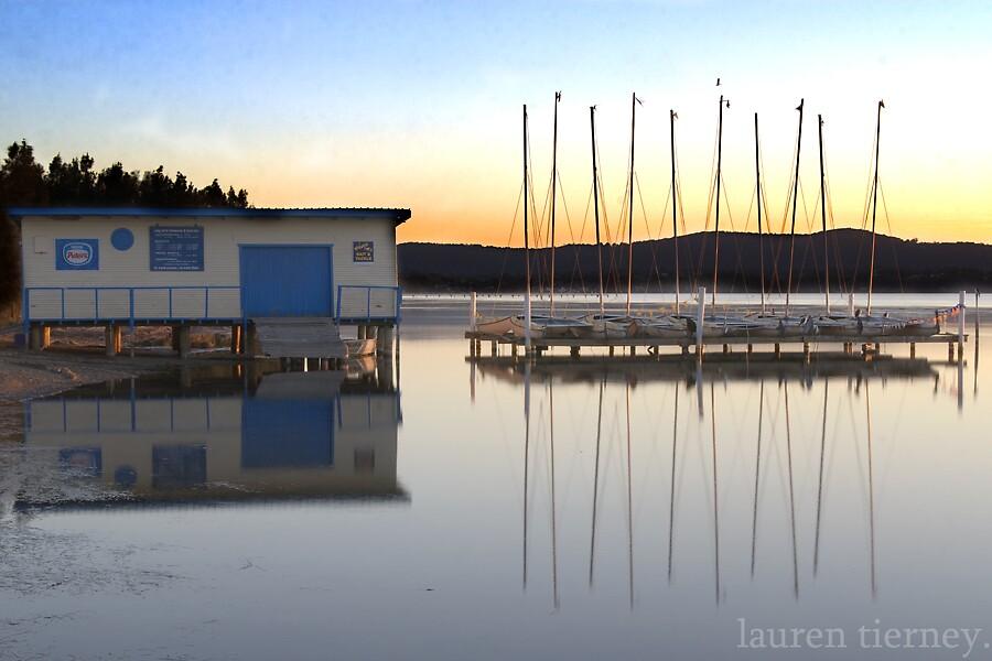 Boat reflection. by Lauren  Tierney