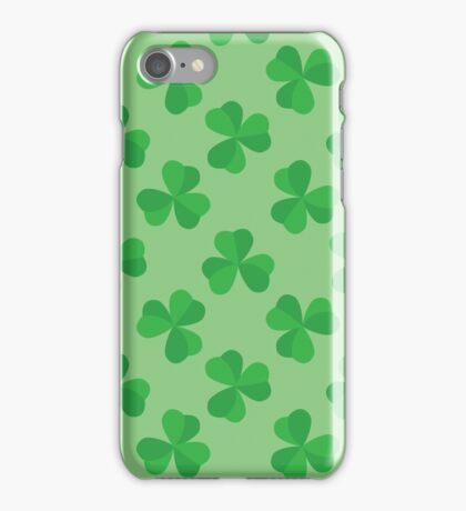 Seamless pattern with leaves of the trefoil on a green background. Happy St. Patrick's day. iPhone Case/Skin