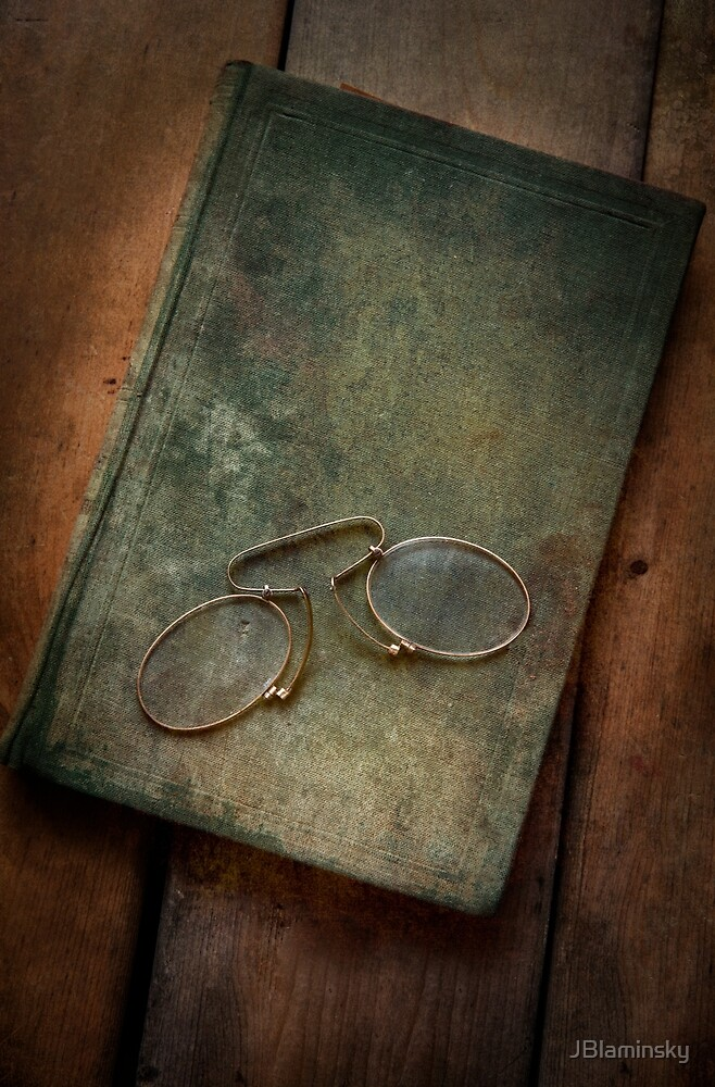 Binocles and old book by JBlaminsky