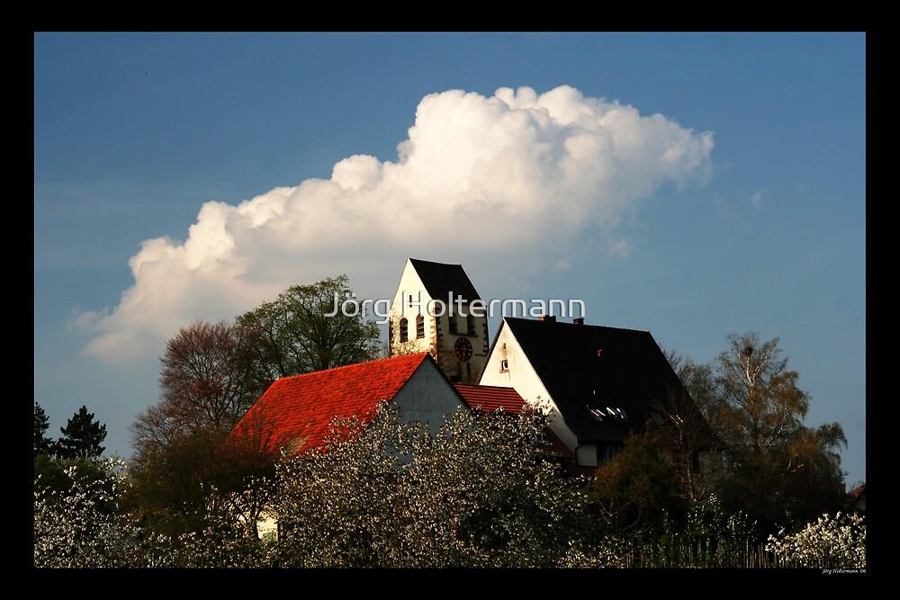 Village hill by Jörg Holtermann