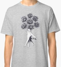 Hand with lotuses on black Classic T-Shirt
