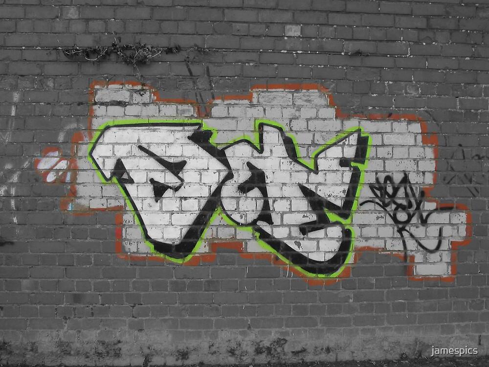graffitti on a wall by jamespics