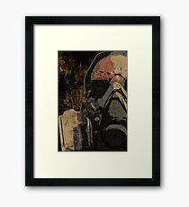 Man with protective mask on dark metal plate background with radiation warning sign Framed Print