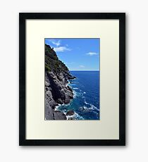 The sea and waves in the rocks in Portofino, Italy Framed Print