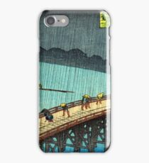 Pedestrians crossing a bridge during a rain storm - Hiroshige Ando - 1857 iPhone Case/Skin