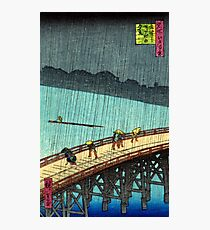 Pedestrians crossing a bridge during a rain storm - Hiroshige Ando - 1857 Photographic Print