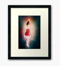 Young sexy woman in a red corset wearing Santa hat on white background Framed Print