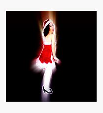 Young sexy woman in a red corset wearing Santa hat on white background Photographic Print