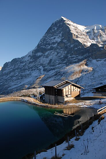 Eiger north face with small lake. by peterwey