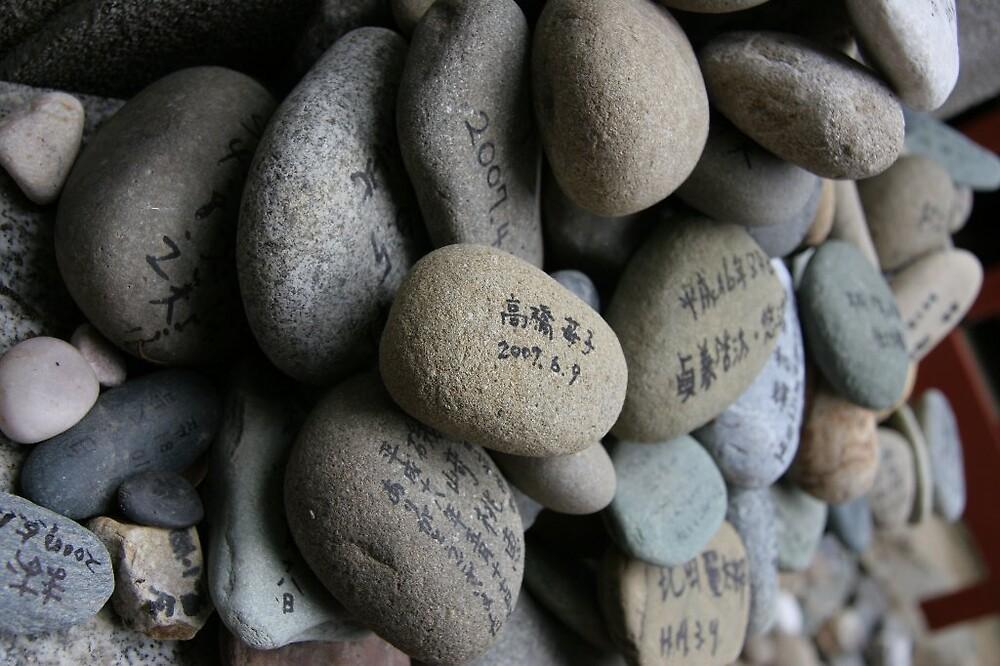 Prayer stones - Temple 51 shiteji temple Matsuyama in Ehime prefecture   by Trishy