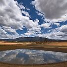 Dam Reflections by Peter Daalder