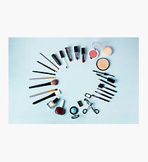 Various make-up products expended as round on blue Photographic Print