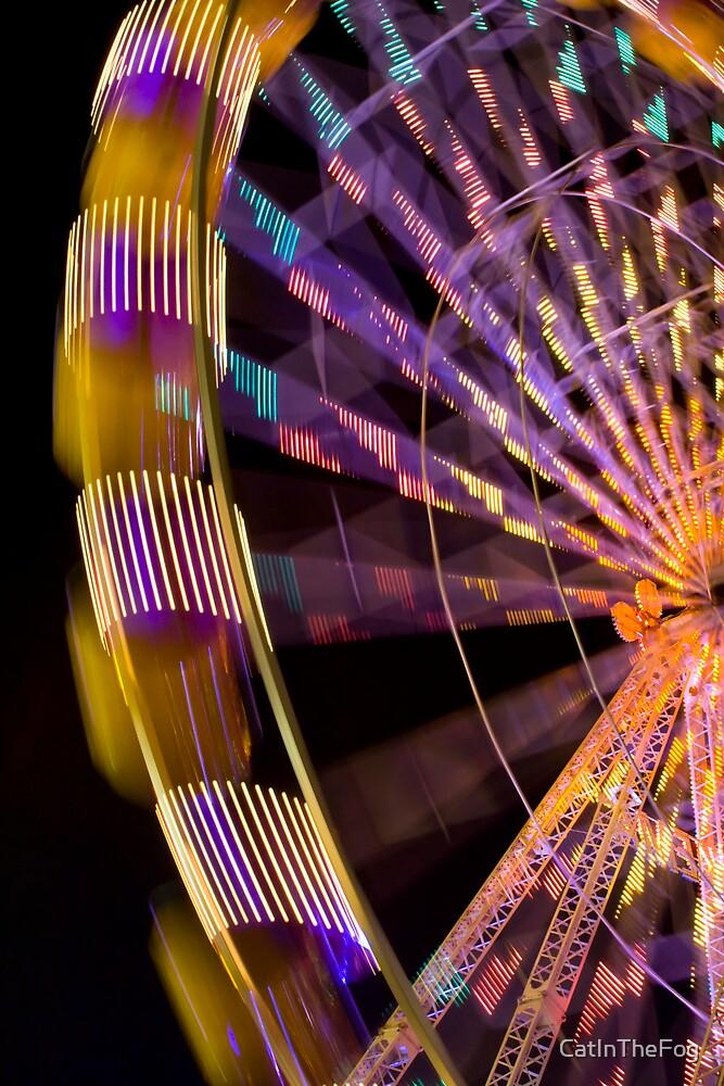 Illuminated ferris wheel by CatInTheFog
