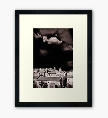 Cloud over Tuscania village, Italy. Framed Print