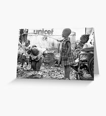 Street kids playing 'skippy' with disused iron bar, Democratic Republic of Congo Greeting Card