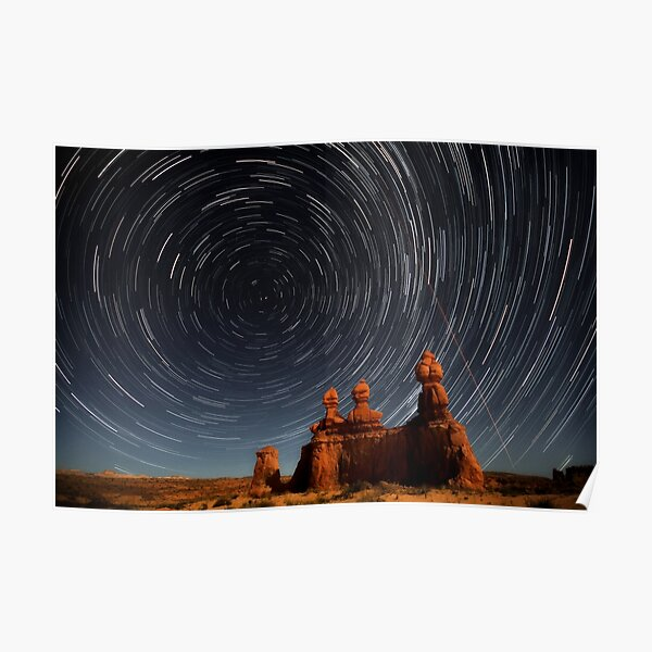 Star trails in Goblin valley Poster