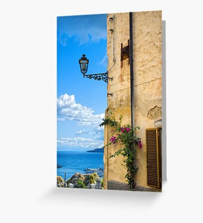 House with bougainvillea, street lamp and distant sea Greeting Card