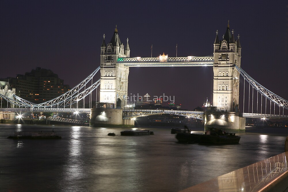 Tower Bridge illuminated in the Evening by Keith Larby