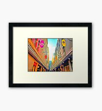 Passage between colorful buildings Framed Print