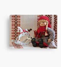 puppet with rocking horse Canvas Print