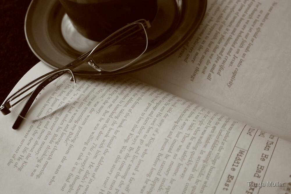 Reading with a cup of coffee  by Tanya Muller