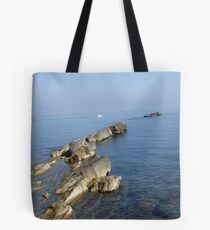 here the sea is divided... and the earth has beginning Tote Bag