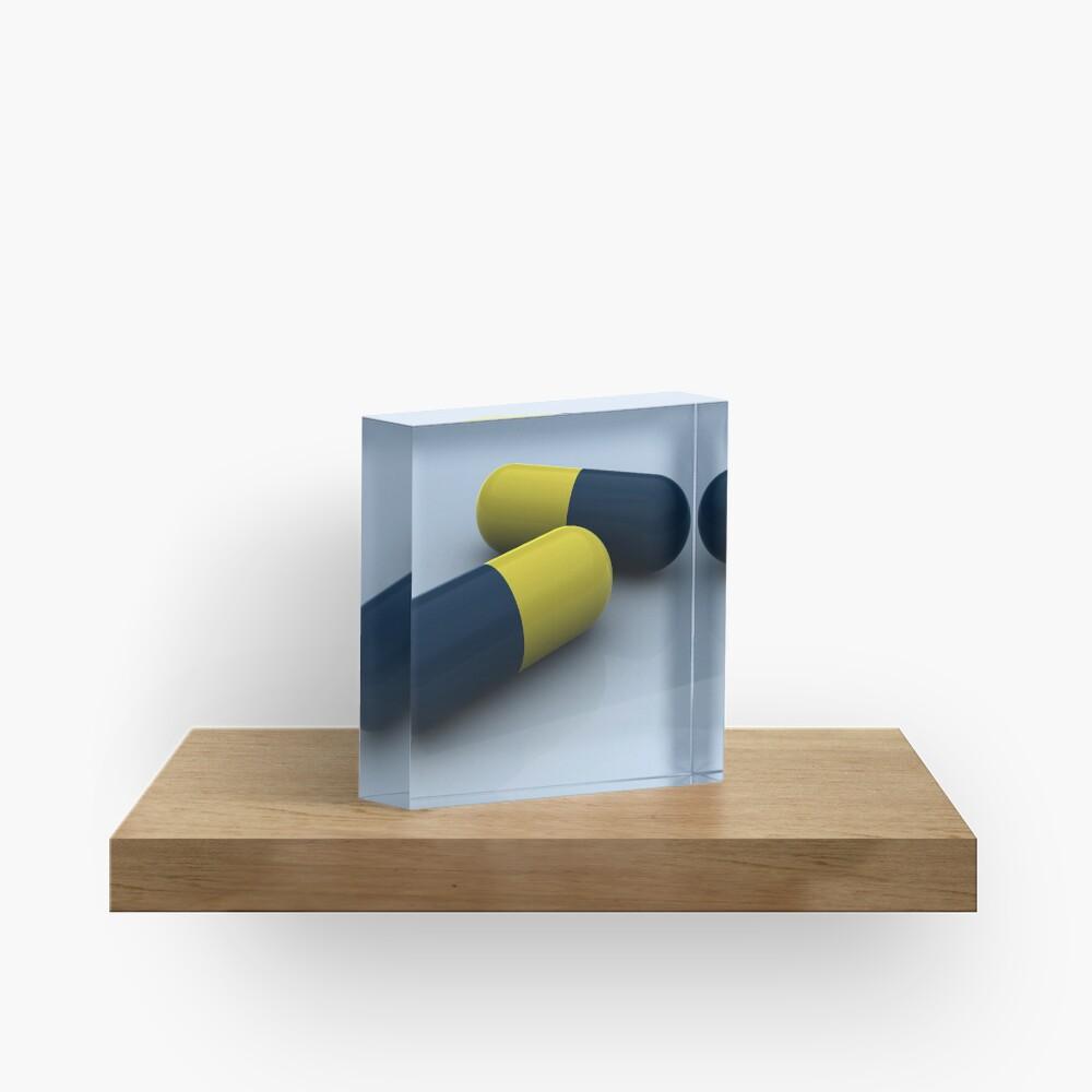Blue and yellow medication capsules. Acrylic Block