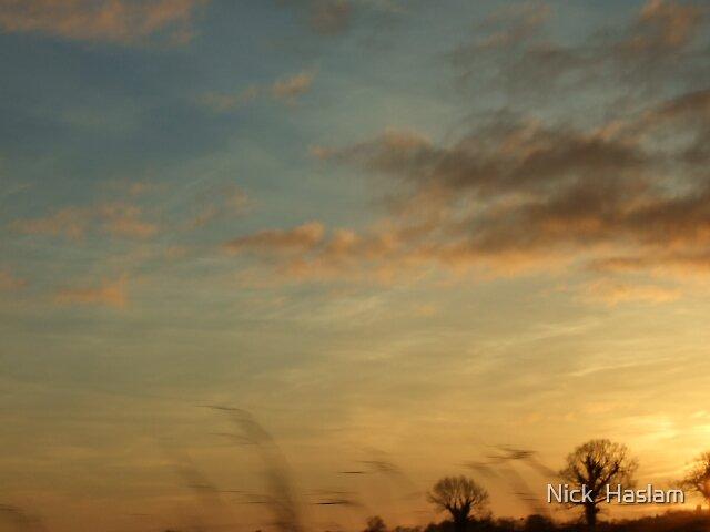 sunrise skys by Nick  Haslam