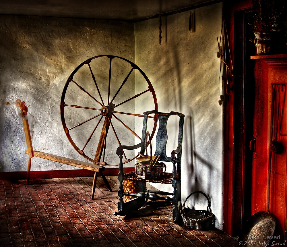 Spinning wheel and a chair by Mike  Savad