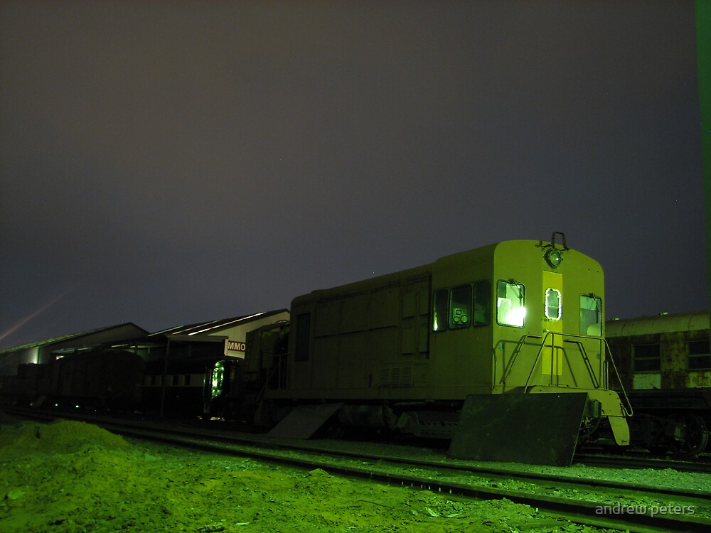 rail yard at night by andrew peters