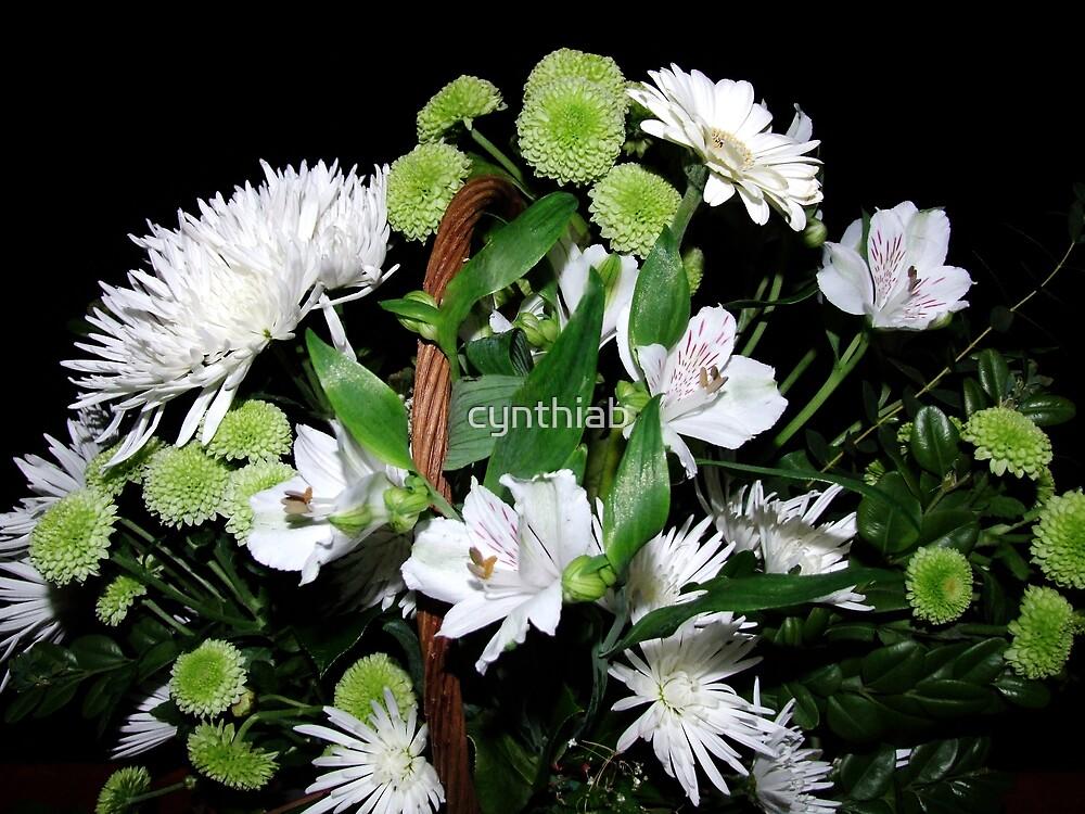 basket of white flowers by cynthiab